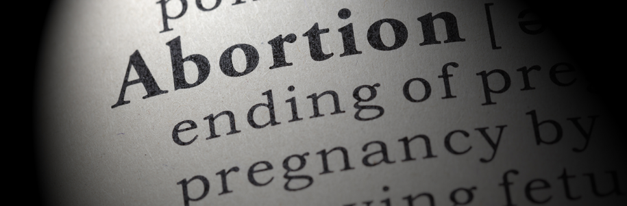 Photo: Dictionary definiton of abortion