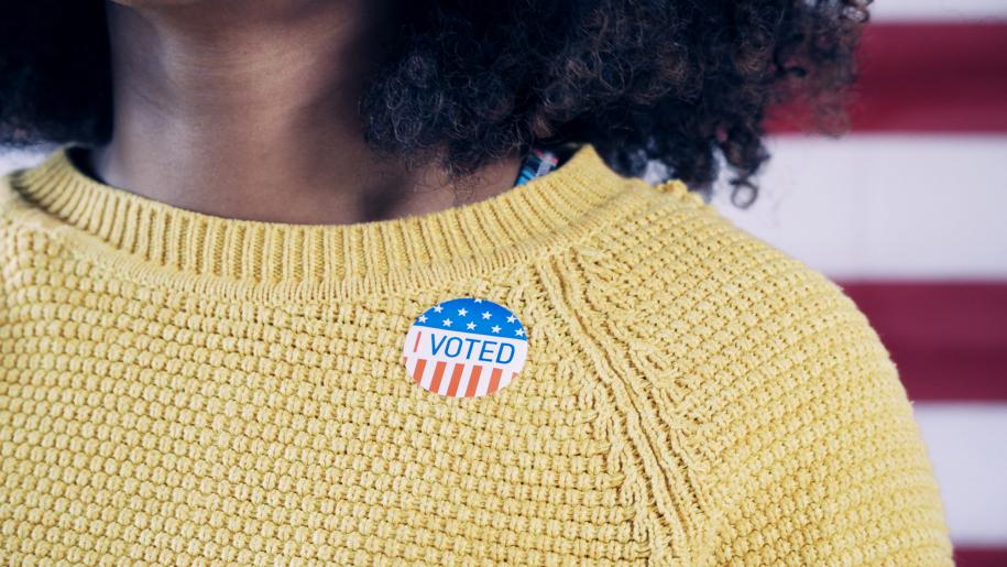 Photo: Woman with I Voted sticker